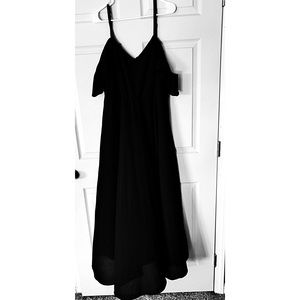 Long full length gown with cold shoulder sleeve.